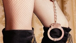 a woman's legs with boots and handcuffs