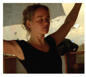 woman with arms stretched open, peaceful face