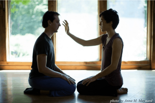 Two seated people looking at each other