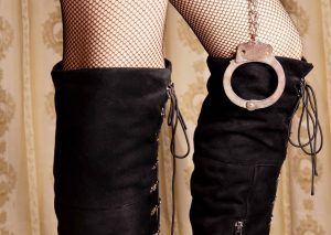 woman's boots and handcuffs