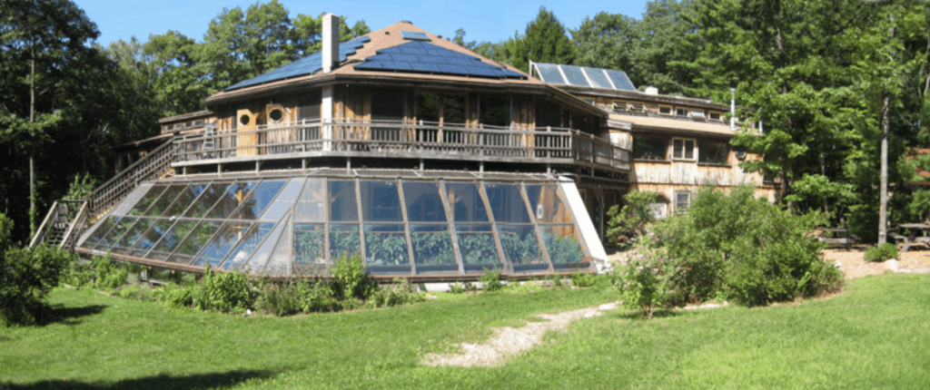 Sirius Eco-Village round barn with greenhouses